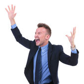 Business man shouts with hands in air — Stock Photo