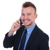 Business man talks on phone — Stock Photo