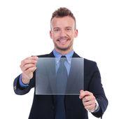 Business man presents transparent screen — Stock Photo