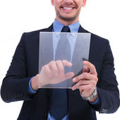 Business man works on transparent touch screen — Stock Photo