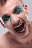 Casual man with makeup laughs out loud — Stock Photo