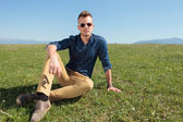 Casual man laying in the grass — Stock Photo