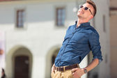 Casual man leans back to sunbathe — Stock Photo
