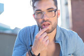 Casual man touches his lower lip — Stock Photo