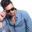 Casual man with hand on sunglasses — Stock Photo