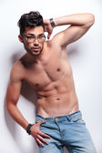 Topless young man with hand at his head — Stock Photo