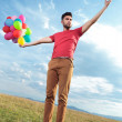 Stock Photo: Casual mcreates illusion of holding balloons