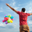 Rear view of casual man with balloons — Stock Photo