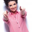 Young casual woman pointing her fingers — Stock Photo