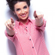 Stock Photo: Young casual woman pointing her fingers