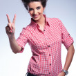 Young casual woman making the victory sign — Stock Photo