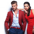 Young fashion man and woman against white wall — Stockfoto