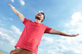 Casual man screaming at the sky — Stock Photo