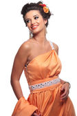Smiling beauty woman in corai dress — Stock Photo
