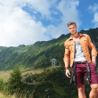 Stock Photo: Casual mwith hand in pocket, in mountains