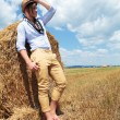 Fashion man in hay field — Stock Photo