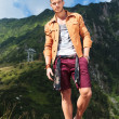 Casual man in the mountains with hand in pocket — Stock Photo