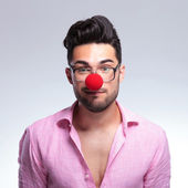Fashion young man with a red nose — Stock Photo