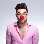 Emotionless fashion young man with red nose — Stock Photo