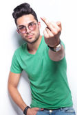 Casual man flipping you off — Stock Photo