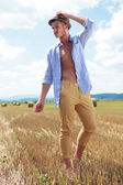 Casual man outdoor looks away with shirt unbuttoned — Stock Photo