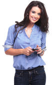 Casual woman with a phone in her hand — Stock Photo