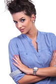 Curious casual woman with folded arms — Stock Photo