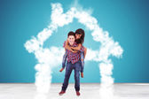In love couple standing in a house made of clouds — Stock Photo