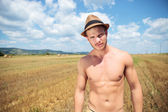 Topless man outdoor posing with hat on head — Stock Photo