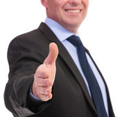 Business man offers hand for shaking — Foto Stock