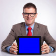 Young business man holds a tablet at his desk — Stock Photo
