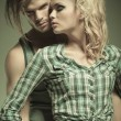 Embraced fashionable man and woman — Stock Photo