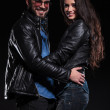 Couple in leather jacket standing embraced and smile — Stock Photo