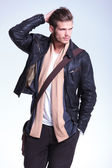 Man in leather jacket is looking away to his side and smiles — Stock Photo