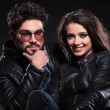 Stock Photo: Young couple in leather jackets, pensive man