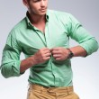 Casual man unbuttoning his shirt — Stock Photo