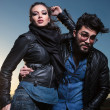Fashion couple in leather clothes posing outdoor — Stock Photo