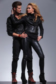 Man and woman in fashionable leather clothes looking at each — Stock Photo