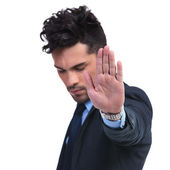 Young business man making the stop hand sign — Stock Photo