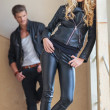 Fashion man and woman in leather clothes posing — Stock Photo
