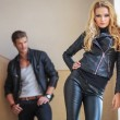 Fashion couple in leather clothes posing — Stock Photo #36007387