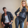 Stock Photo: Fashion couple in leather clothes posing