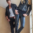 Man in leather clothes is checking a woman out — Stock Photo