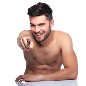 Young naked man pointing finger to camera — Stock Photo