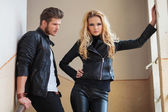 Man in leather jacket is lookin at his girlfriend — Stock Photo