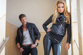 Fashion couple in leather clothes posing — Stock Photo