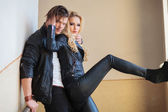 Couple in leather clothes standing embraced — Stock Photo