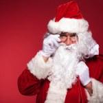 Santa claus holding his glasses — Stock Photo #36084267