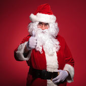 Santa claus is making the ok thumbs up ok sign — Stock Photo