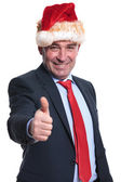 Busines man in santa claus hat making the ok sign — Stock Photo